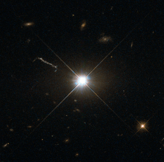 This image from Hubble's Wide Field and Planetary Camera 2 (WFPC2) is likely the best of ancient and brilliant quasar 3C 273, which resides in a giant elliptical galaxy in the constellation of Virgo